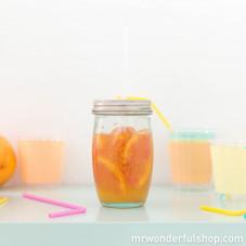 Bicchiere di vetro con cannuccia