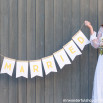 Paper pennants with letters on them